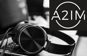 a2im logo over headphones on a laptop