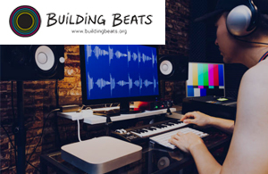 building beats logo in front of a person working at a sound editing station